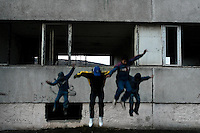 Young boys jump out of the window of a devastated apartment block in the Gipsy ghetto of Chanov on outskirts of Most, Czech Republic, 19 December 2008.