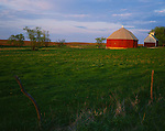 LaSalle County, IL<br /> Evening ligh on round barn & fenced in spring pasture