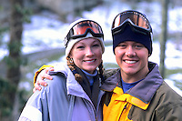 Teenage friends enjoying each others company on the ski slopes