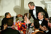 Washington, D.C. - February 6, 2006 -- United States President George W. Bush toasts Arthur Mitchell, Kennedy Center Former Honoree, Founder and Artistic Director, Dance Theatre of Harlem in Washington, D.C. on February 6, 2006.  Left to right: Arthur Mitchell, first Lady Laura Bush, President Bush, Governor George Pataki (Republican of New York)<br /> Credit: Ron Sachs / CNP