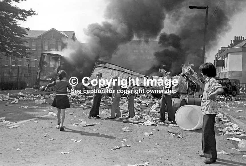 The fifth anniversary of the introduction of internment on 9th August 1971 was marked with disturbances and the hijacking and burning of vehicles. This picture was taken on the Falls Road, Belfast, N Ireland. 197608090356c.<br />