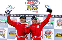 LEXINGTON, OH - SEPTEMBER 17:  Race winners Enzo Potolicchio, right, and Ryan Dalziel celebrate their win after the EMCO Gears Classic at Mid-Ohio Sports Car Course on September 17, 2011 in Lexington, Ohio.  (Photo by Brian Cleary/bcpix.com)