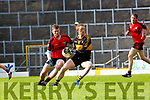 Colm Cooper, Dr Crokes gets his pass away under pressure from Brian O'Sullivan, Kenmare during the County League Div 1 final on Sunday in Fitzgerald Stadium.