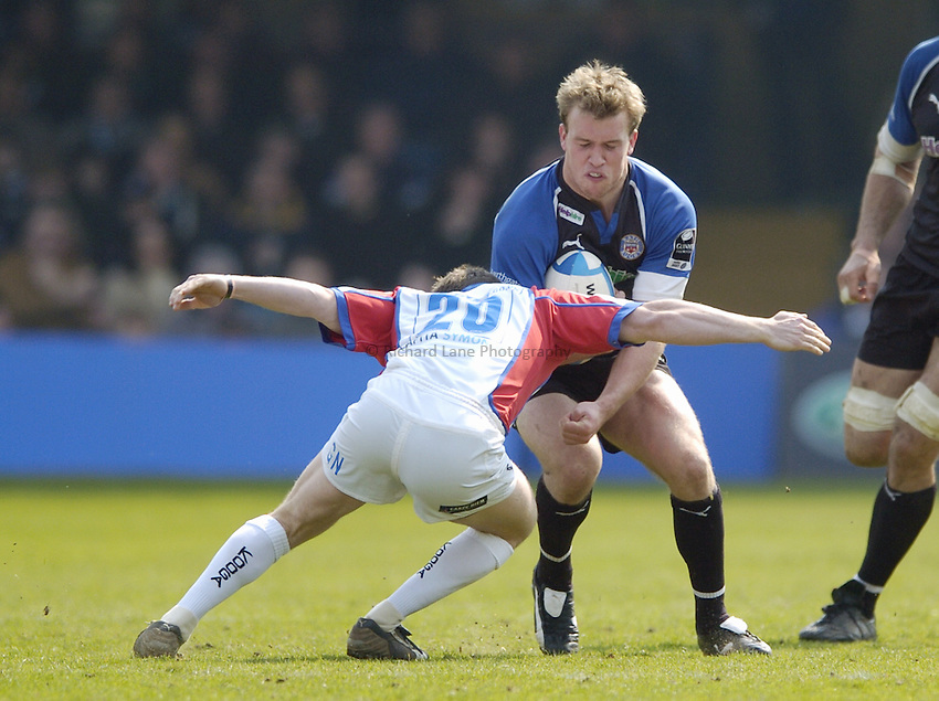Photo: Jonathan Butler..Bath Rugby v Bristol Rugby. European Challenge Cup. 31/03/2007..Tom Cheeseman (R) of Bath is tackled by Greg Nicholls of Bristol.