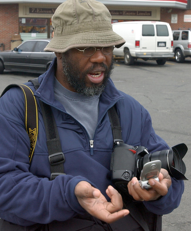 Newsday photographer, John Conrad Williams, at the Intersection of Ocean Ave and Horse Block Road in Farmingville on Wednesday October 5, 2005. (Newsday Photo / Jim Peppler).