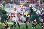 Wisconsin Badgers offensive linemen Peter Konz (66) and Travis Frederick (72) pass block as quarterback Russell Wilson (16) drops back to pass during the 2012 Rose Bowl NCAA football game in Pasadena, California on January 2, 2012. The Ducks won 45-38. (Photo by David Stluka)