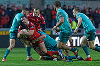 Ryan Elias of the Scarlets (C) is brought down by Bill Johnston (L) and Jeremy Loughman of Muster during the Guinness Pro14 Round 17 match between the Scarlets and Munster Rugby at the Parc Y Scarlets Stadium, Llanelli, Wales, UK. Saturday 02 March 2019