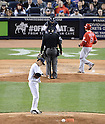 Masahiro Tanaka (Yankees),<br /> APRIL 27, 2014 - MLB :<br /> Pitcher Masahiro Tanaka of the New York Yankees reacts after giving up a home run to David Freese of the Los Angeles Angels who crosses home plate in the sixth inning during the Major League Baseball game at Yankee Stadium in Bronx, New York, United States. (Photo by AFLO)