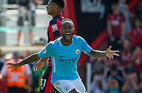 Raheem Sterling of Manchester City turns to celebrate scoring his 97th minute winning goal during the Premier League match between Bournemouth and Manchester City at the Goldsands Stadium, Bournemouth, England on 26 August 2017. Photo by Andy Rowland.