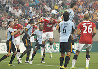 Juan Pablo Angel #9 of the MLS All-Star misses a header that goes to Fredrico Macheda #27 of Manchester United who headed in the second goal for United during the 2010 MLS All-Star match at Reliant Stadium, on July 28 2010, in Houston, Texas. Manchester United won 5-2.