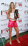 "Actress Denise Richards arrives at the Much Love Animal Rescue Presents The Second Annual ""Bow Wow WOW!"" at The Playboy Mansion on July 19, 2008 in Beverly Hills, California."