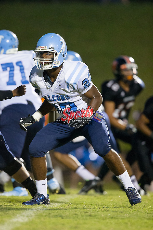 LJ Robinson (22) of the West Rowan Falcons on special teams during first half action against the Northwest Cabarrus Trojans at Trojan Stadium September 19, 2014, in Concord, North Carolina.  The Falcons defeated the Trojans 13-0.  (Brian Westerholt/Sports On Film)