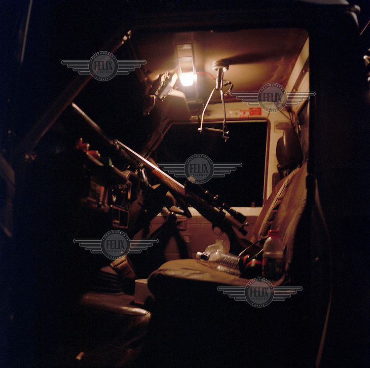 A gun mounted inside the pickup cab of Rob Everington, a professional licensed kangaroo hunter. On an average night Rob kills around 40 kangaroos, earning him around $1000 AUD for one night's work. Kangaroos are hunted for their meat and their skins, which produce high quality leather.