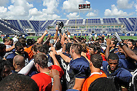 22 August 2009:  FIU's team gathers mid-field after a scrimmage during the FIU Select-A-Seat Open Practice at FIU Stadium in Miami, Florida.