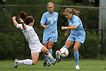 18 September 2009: North Carolina's Courtney Jones (right) is defended by LSU's Allysha Chapman (CAN) (left) as Whitney Engen (9) watches. The University of North Carolina Tar Heels defeated the Louisiana State University Tigers 1-0 at Koskinen Stadium in Durham, North Carolina in an NCAA Division I Women's college soccer game.