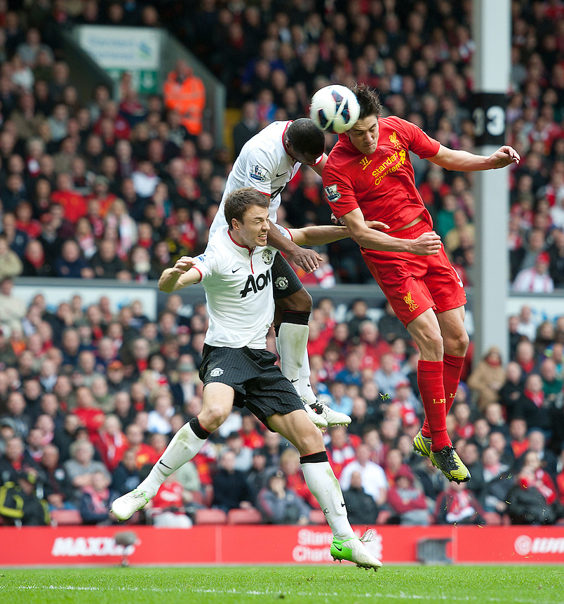 Liverpool's Martin Kelly beats Manchester United's Patrice Evra and Jonny Evans to the ball but his header is saved..Football - Barclays Premiership - Liverpool v Manchester United - Sunday 23rd September 2012 - Anfield - Liverpool..