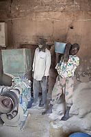 SEGOU, MALI - FEBRUARY 24: Men use a machine to clean rice on February 24 2011, outside Segou, Mali. Photo by Per-Anders Pettersson