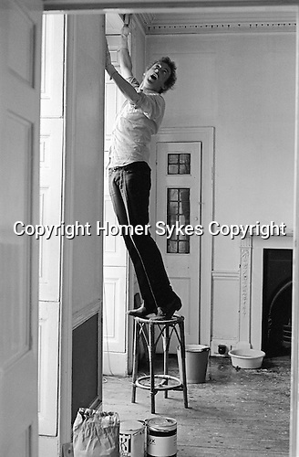 Patrick Procktor artist London 1969. PP decorating his Manchester Street flat, helping him is fellow artist and friend Mo McDermott,who is out of shot.