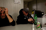 Kendrick Brinson.LUCEO..Kent Stafford, 56, of Rochester, Minnesota, relaxes as colleague Heath Sprague eats a microwaveable meal directly after a 12.5 hour night shift on an Ensign Drilling Rig outside of Williston, North Dakota, seen January 2012. Kent and his colleagues share a mancamp, which is a trailer just steps from the rig with two bedrooms and six bunk beds. ..Williston is currently experiencing an influx of people relocating there for the town's third oil boom. ..Model Released: yes.Assigning Editor: Michael Wichita.