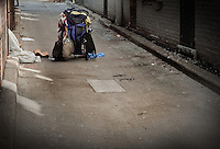 A homeless person sleeps in a back alley in Toronto April 19, 2010.