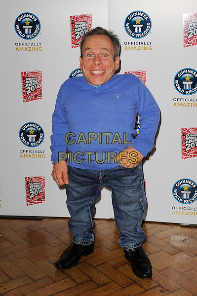 Warwick Davis <br /> The Guinness World Records 2014 Launch Party, One Marylebone, London, England. <br /> 17th September 2013<br /> full length blue top jeans denim<br /> CAP/MAR<br /> &copy; Martin Harris/Capital Pictures