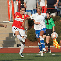 Western New York defender Katherine Reynolds (14) passes the ball as Boston Breakers forward Kyah Simon (17) pressures. In a Women's Premier Soccer League Elite (WPSL) match, the Boston Breakers defeated Western New York Flash, 3-2, at Dilboy Stadium on May 26, 2012.