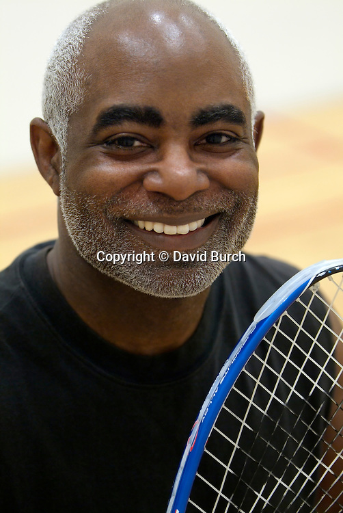 African American man smiling with racketball rackett