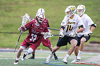 Towson, MD - May 6, 2017: UMASS Minutemen Jesse Leung (32) tries to get pass Towson Tigers Zach Goodrich (14) during game between Towson and UMASS at  Minnegan Field at Johnny Unitas Stadium  in Towson, MD. May 6, 2017.  (Photo by Elliott Brown/Media Images International)