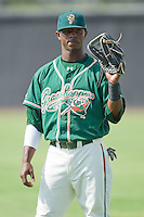 Rand Smith #21 of the Greensboro Grasshoppers warms up in the outfield prior to the South Atlantic League game against the Hickory Crawdads at  L.P. Frans Stadium July 10, 2010, in Hickory, North Carolina.  Photo by Brian Westerholt / Four Seam Images