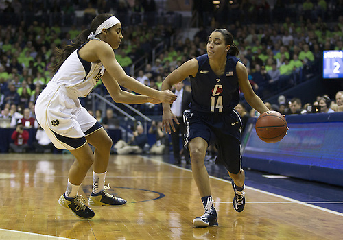 March 04, 2013:  Connecticut guard Bria Hartley (14) dribbles the ball as Notre Dame guard Skylar Diggins (4) defends during NCAA Basketball game action between the Notre Dame Fighting Irish and the Connecticut Huskies at Purcell Pavilion at the Joyce Center in South Bend, Indiana.  Notre Dame defeated Connecticut 96-87 in triple overtime.