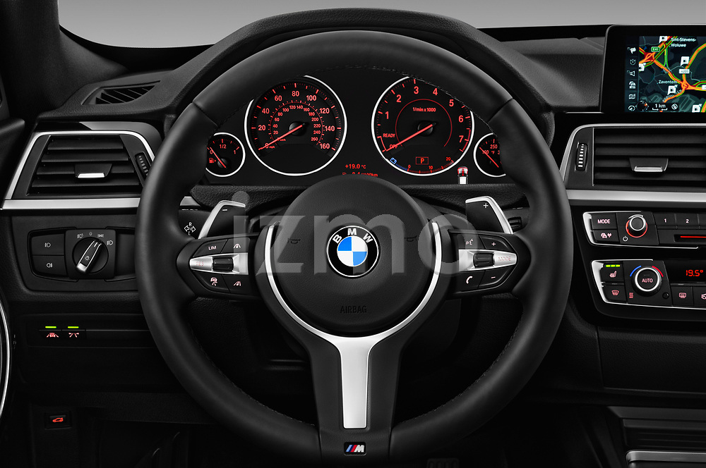 Car pictures of steering wheel view of a 2017 BMW 3 Series 330i GT M Sport 5 Door Hatchback