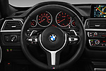Car pictures of steering wheel view of a 2018 BMW 3 Series 330i GT M Sport 5 Door Hatchback