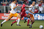 05 June 2009: Chicago's Patrick Nyarko (center) is defended by Houston's Craig Waibel (right) and Geoff Cameron (left). The Houston Dynamo defeated the Chicago Fire 1-0 at Toyota Park in Bridgeview, Illinois in a regular season Major League Soccer game.