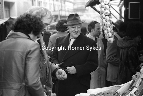 Sir Alec Guinness London UK 1977.  Soho market London UK 1977.