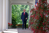 United States President Donald J. Trump walks along the colonnade outside the Oval Office prior to a National Day of Prayer event in the Rose Garden at the White House in Washington, DC on May 3, 2018. Credit: Alex Edelman / Pool via CNP /MediaPunch