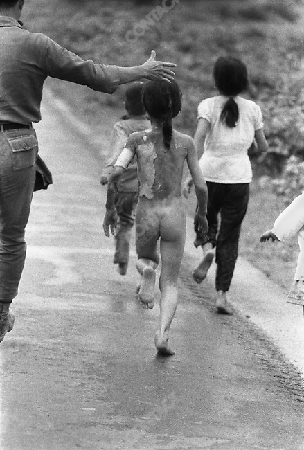Civilians burned by an accidental napalm bombing flee. 9 year old Pham Thi Kim Phuc (center) is amongst the injured, the iconic image by Nick Ut of Kim Phuc running was taken moments before this one. Trang Bang, South Vietnam, June 8, 1972.