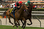 ARCADIA, CA  APRIL 7:   #6 Fatale Bere, ridden by Joel Rosario, battles #5 Ms Bad Behavior, ridden by Kent Desormeaux, in the stretch the Providencia Stakes (Grade lll) on April 7, 2018 at Santa Anita Park Arcadia, CA. (Photo by Casey Phillips/ Eclipse Sportswire/ Getty Images)