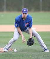 Kerry Wood #34 of the Chicago Cubs participates in pitchers fielding practice during spring training workouts at the Cubs complex on February 19, 2011  in Mesa, Arizona. .Photo by Bill Mitchell / Four Seam Images.