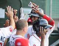 Outfielder Felix Sanchez (34) of the Greenville Drive is greeted in the dugout after scoring a run in a game against the Lexington Legends on June 5, 2011, at Fluor Field at the West End in Greenville, S.C. Photo by Tom Priddy / Four Seam Images