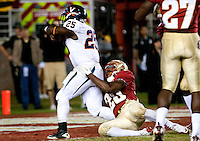 TALLAHASSEE, FL 11/19/11-FSU-UVA111911 CH-Florida State's Lamarcus Joyner is dragged into the endzone by Virginia's Kevin Parks as he scores the winning touchdown during second half action Saturday at Doak Campbell Stadium in Tallahassee. The Seminoles lost to the Cavaliers 14-13..COLIN HACKLEY PHOTO