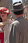 A man wearing a vintage suit and hat and a woman in a red and white vintage dress in the Easter Parade on Fifth Avenue in New York City