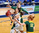 BROOKINGS, SD - JANUARY 6: Macy Miller #12 from South Dakota State University takes the ball to the basket against Macey Kvilvang #14 from North Dakota State University  during their game Saturday afternoon at Frost Arena in Brookings, SD. (Photo by Dave Eggen/Inertia)
