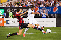 Cristiano Ronaldo (7) of Real Madrid shoots and scores his first goal. Real Madrid defeated A. C. Milan 5-1 during a 2012 Herbalife World Football Challenge match at Yankee Stadium in New York, NY, on August 8, 2012.