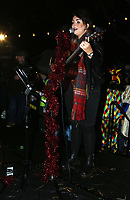 Pictured: A female performer on stage for the Christmas Lights switch on in Ystradgynlais, Wales, UK.<br /> Re: Hundreds of people gathered in Ystadgynlais, south Wales, for the Christmas lights switch on by actor Michael Sheen.<br /> The Port Talbot-raised, Hollywood actor led the big countdown to begin the Christmas festivities in Gorsedd Park.<br /> The event comes in the wake of the star taking a shine to the area after filming for a TV programme.