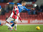 St Johnstone v Hamilton Accies…28.01.17     SPFL    McDiarmid Park<br />David Wotherspoon skips by Scott McMann<br />Picture by Graeme Hart.<br />Copyright Perthshire Picture Agency<br />Tel: 01738 623350  Mobile: 07990 594431
