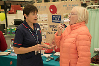 Specialist Respiratory Nurse Alison Sutherland demonstrates the Spirometer test to Asda customer Sandra Speyers of Edwalton