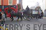 HORSE DRAWN FUNERAL: On Thursday morning shoppers in Castle Street, Tralee, stood still to let a horse-drawn carriage carrying the remains of Kathleen Quilligan, No. 1 Mitchels Crescent, Tralee, from St. Johns Church, Castle St., to her final resting place in Rath Cemetery, followed by a large crowd of family, friends and neighbours.