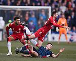 08.03.2020: Ross County v Rangers: Ross Stewart tackles Matt Polster as Connor Goldson watches on
