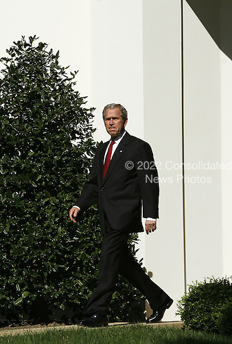 Washington,DC - October 10, 2007 -- United States President George W. Bush makes a statement on the Protect America Act of 2007, which passed Congress last August, on the South Lawn of the White House in Washington, D.C. on Wednesday, October 10, 2007.  The Act, which strengthens the Foreign Intelligence Surveillance Act (FISA), is due to expire in February, 2008.  The President called on Congress to pass the act permanently..Credit: Aude Guerrucci - Pool via CNP