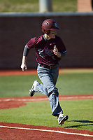 Nathan Neff (5) of the Concord Mountain Lions hustles down the first base line against the Wingate Bulldogs at Ron Christopher Stadium on February 2, 2020 in Wingate, North Carolina. The Mountain Lions defeated the Bulldogs 12-11. (Brian Westerholt/Four Seam Images)